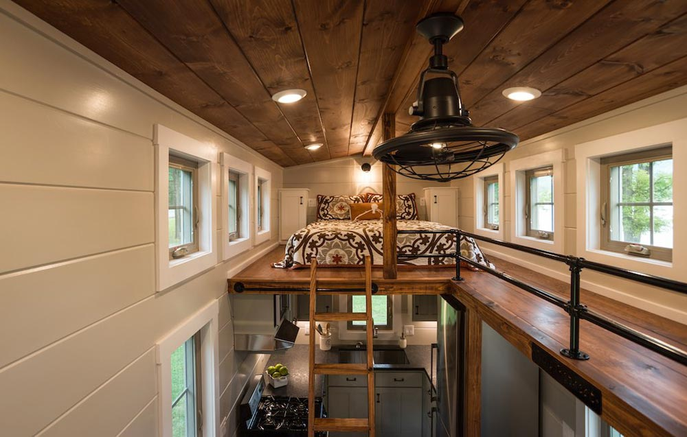 Above the kitchen is one of the loft bedrooms which can be accessed via a ladder