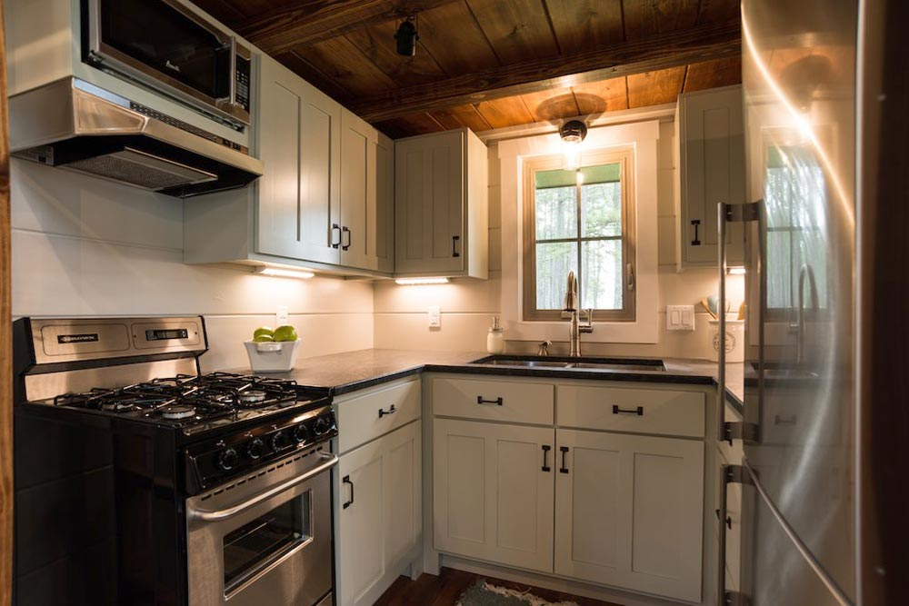 A small window opens up the kitchen and makes it feel less closed in