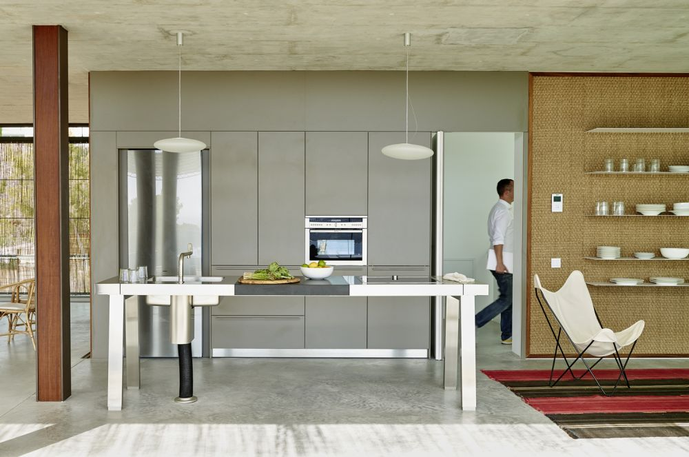The open kitchen area features a flat and minimalistic design and color palette which helps it stand out more