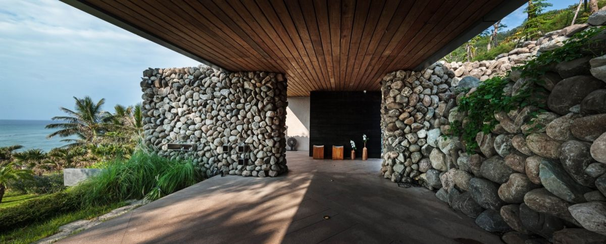 A'tolan house in Taiwan rock walls and wood terrace
