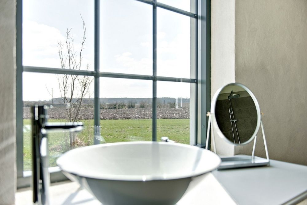 Large windows let in lots of natural light but also expose the house to the panoramic views of its surroundings