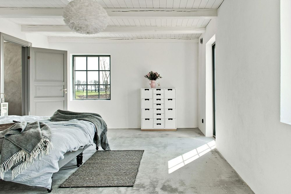 The bedrooms don't have high ceilings but feature white walls and polished concrete floors, just like the great room