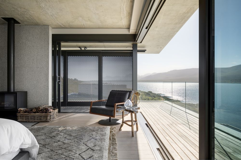 The master suite has its own private terrace with transparent glass railings which allow the views to freely become a part of the interior decor
