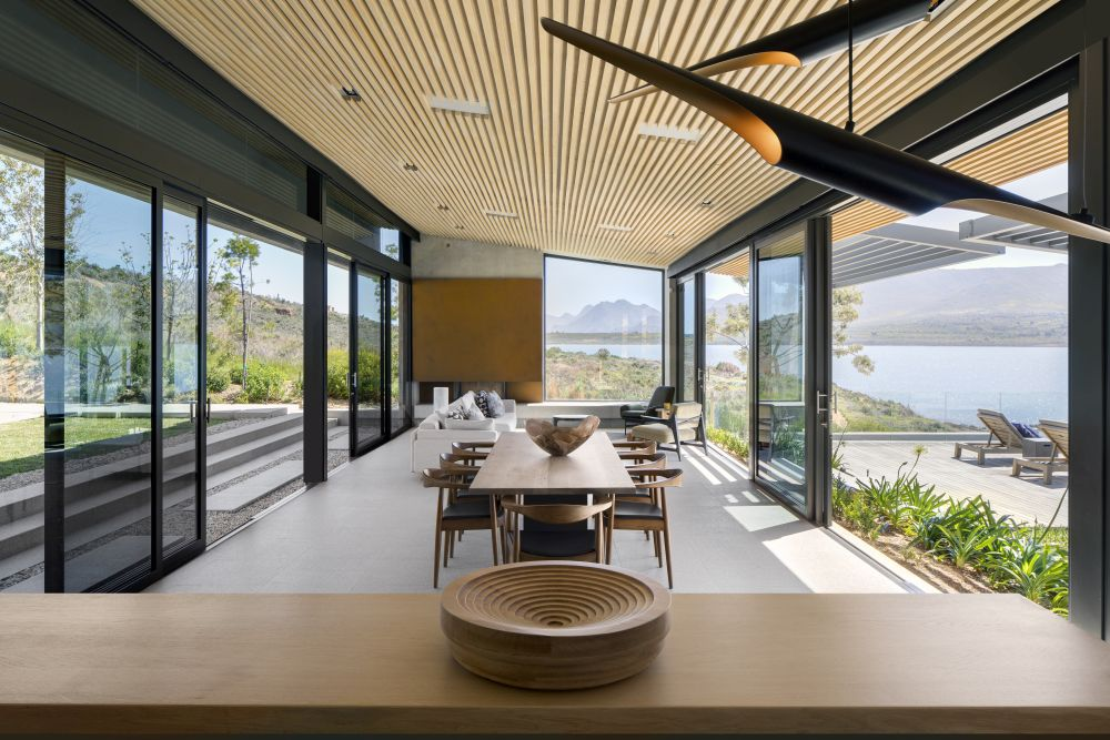 Sliding glass doors allow a seamless transition between the interior and exterior spaces while also letting air, light and views through