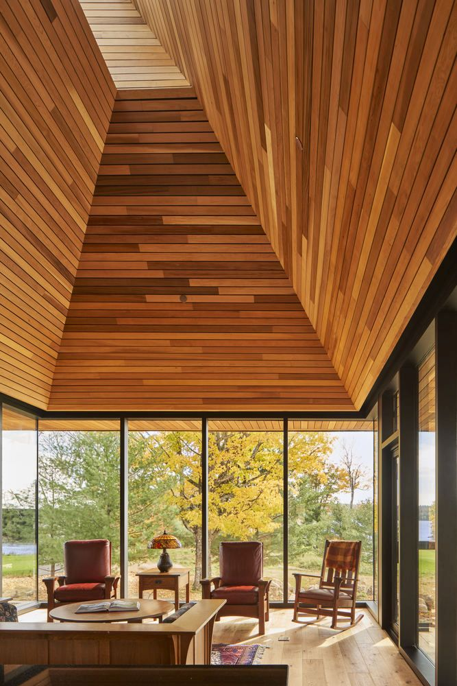 The shiplap wooden walls also reference the interior of a canoe