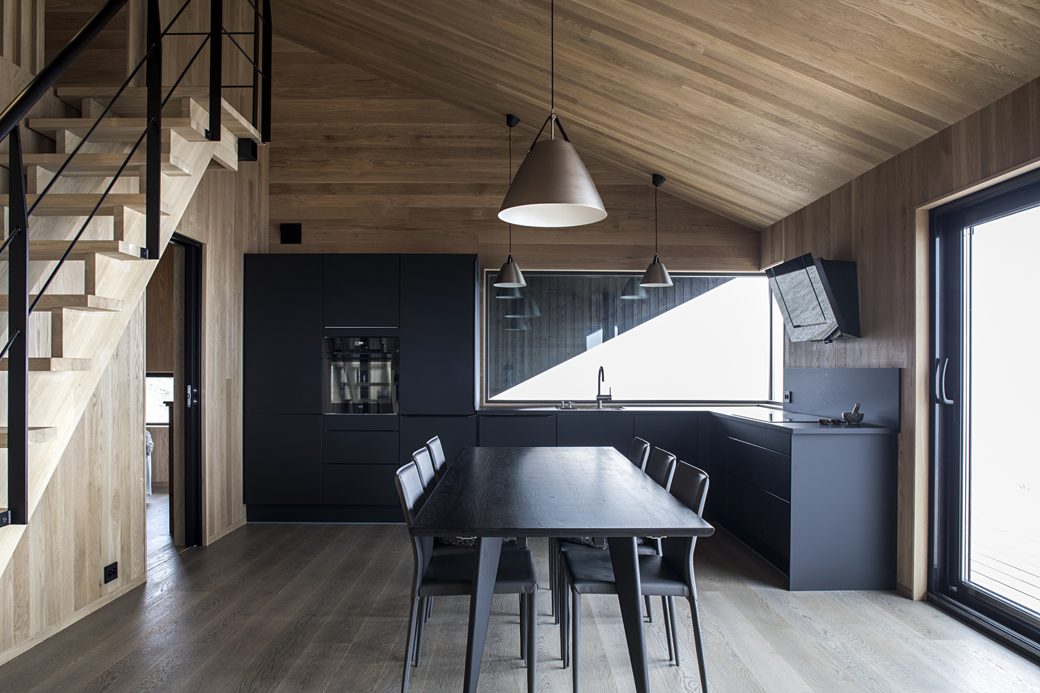 The gabled roof allows the cabin to include a cozy attic level which serves as a sleeping area for eight