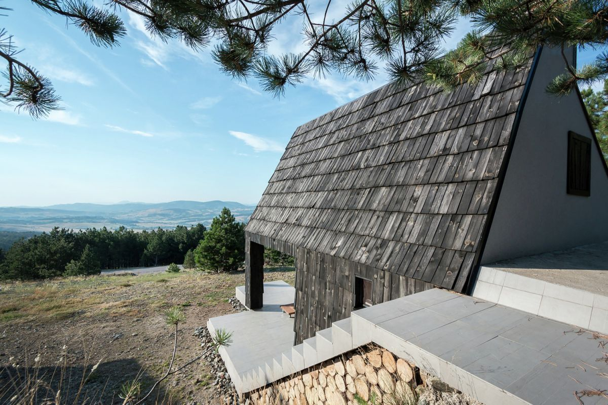 Black and white house in Serbia dark roof section
