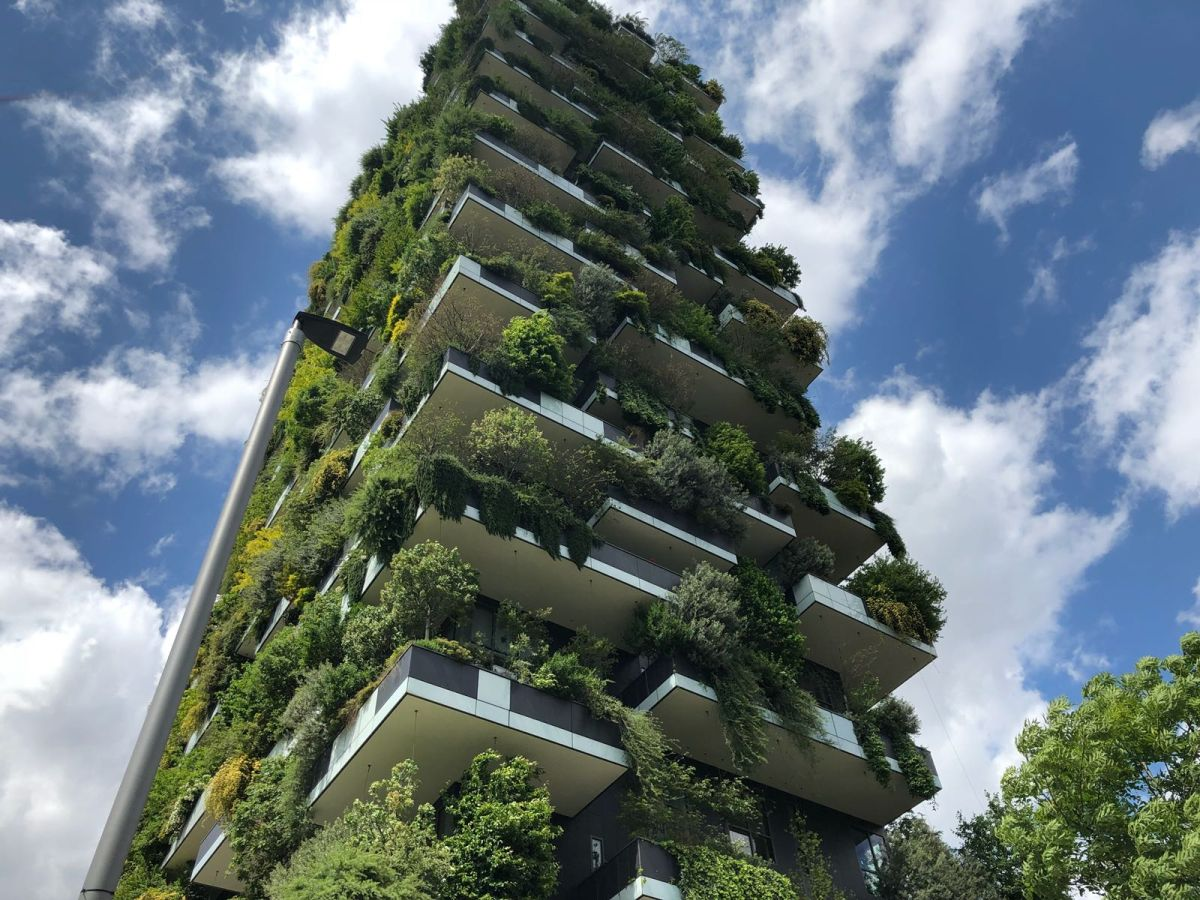 The massive amount of greenery is colonized by birds and insects and helps to make the towers burst with energy
