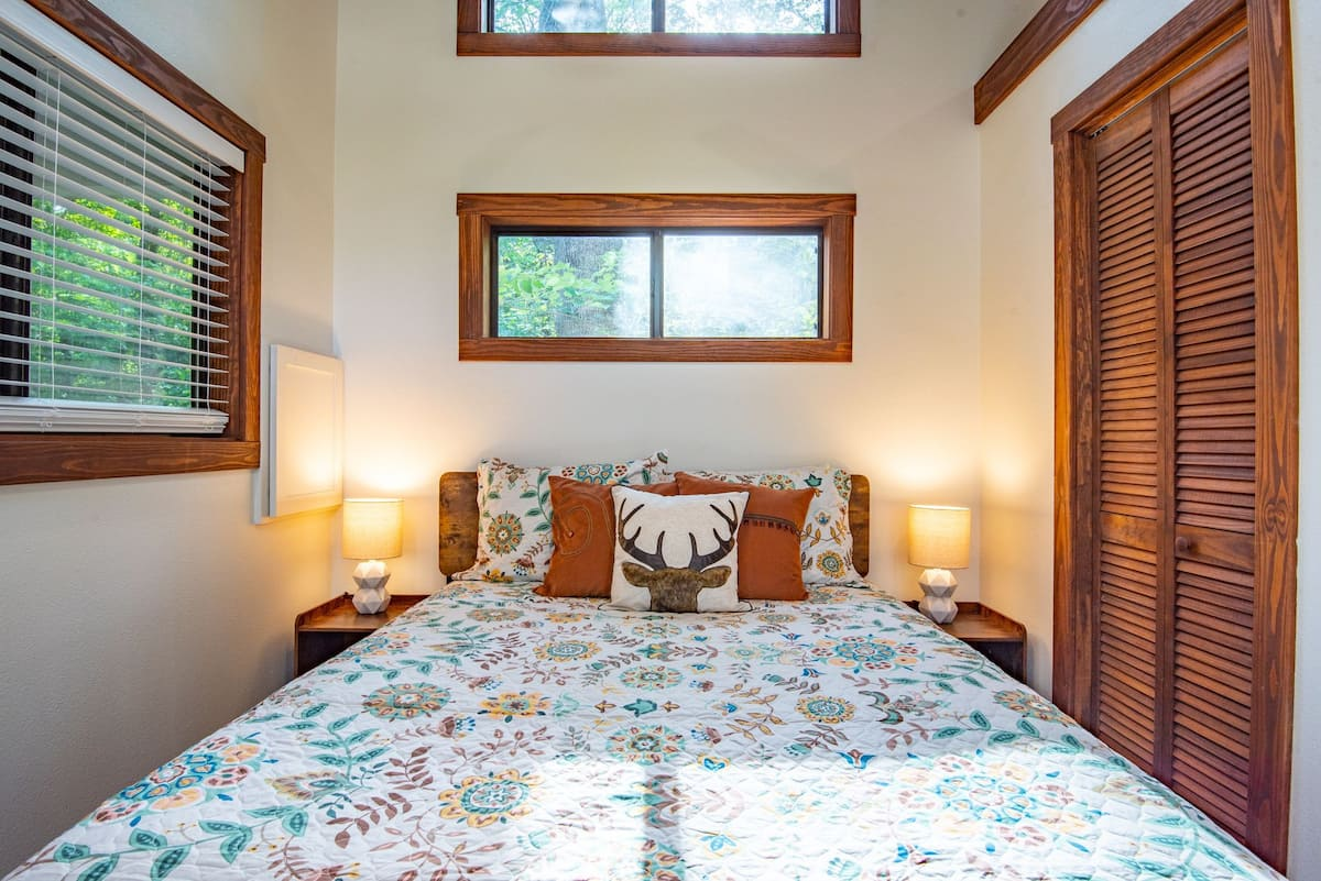 The bedroom is big enough for a queen-size bed and a closet with a bit of space to walk around