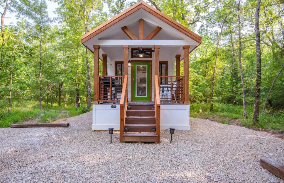 The front porch is small but frames the front door in a lovely way and is really cozy too