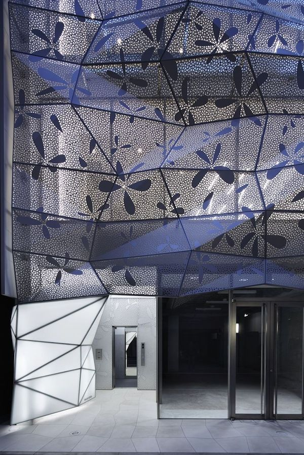Building Dressed in Glass and Perforated Metal