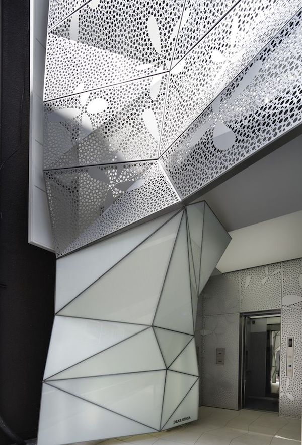 Building Dressed in Glass and Perforated Metal1