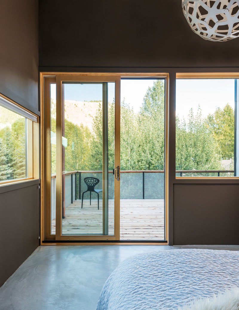cache-creek-residence-brown-bedroom-walls-and-balcony