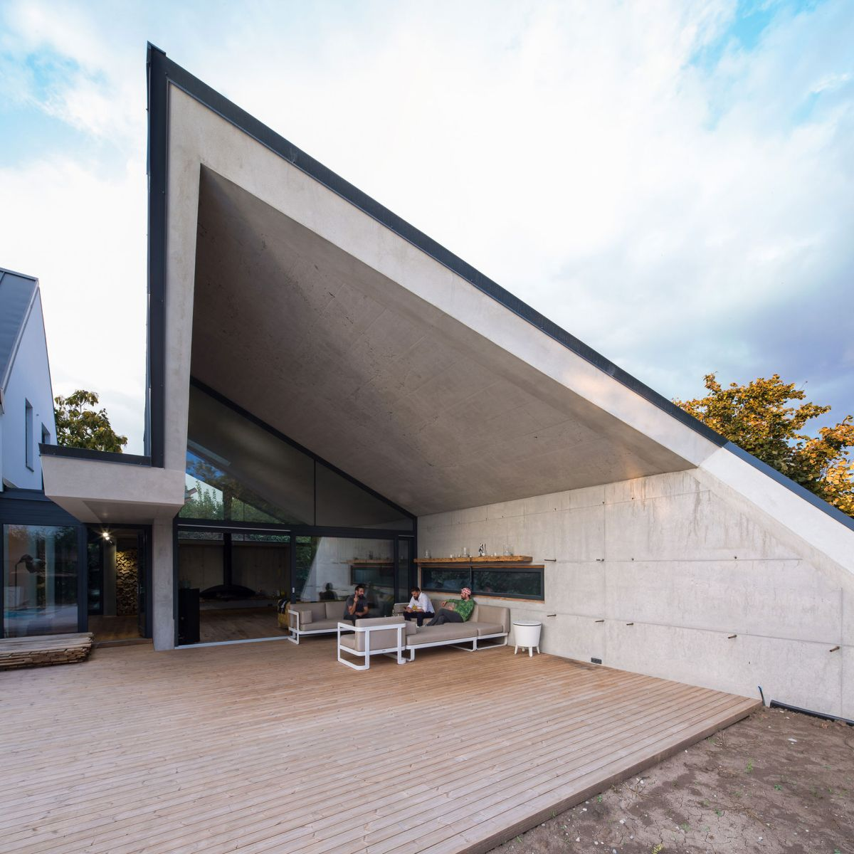 Casa G3 in Otopeni sculptural pitched roof extension