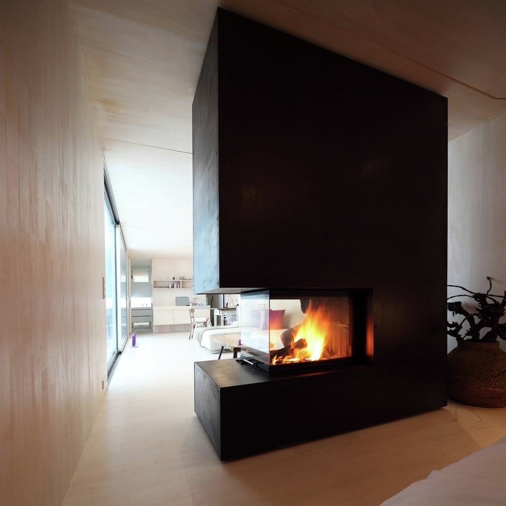 Casa Invisible concept two-sided fireplace