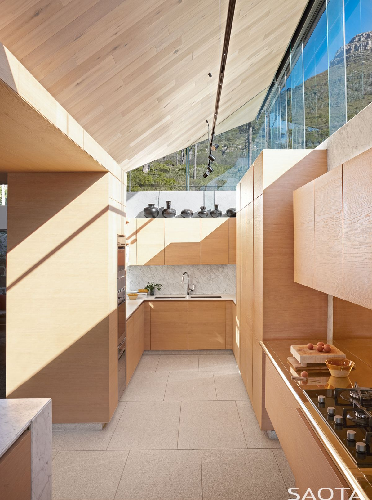 The kitchen, in spite of having an open floor plan, looks and feels like a separate, cozy nook