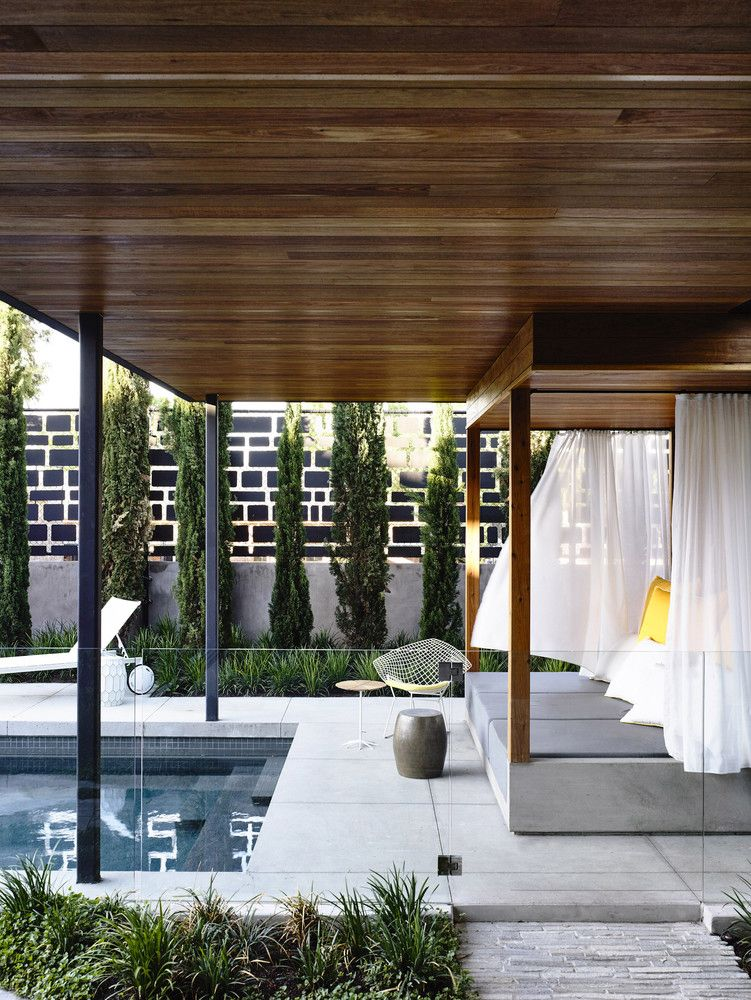 On the ground floor the living area and master bedroom extend out into the garden and poolside area