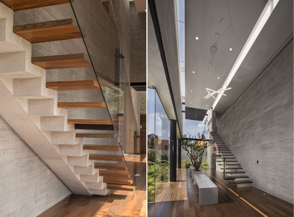 The staircase is a major design feature for the entire ground floor. It has a concrete structure and floating wooden steps