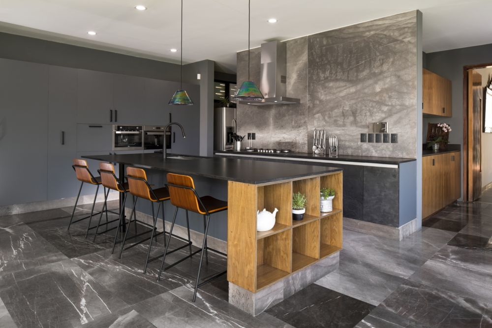The kitchen communicates with the living room and dining area and features a large island