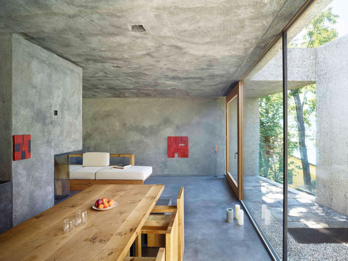Concrete House in Caviano living and dining