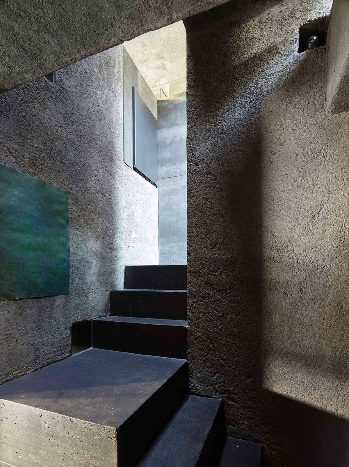 Concrete House in Caviano staircase and skylight