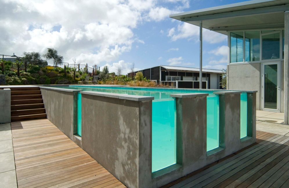 Concrete Swimming Pool With Glass Windows