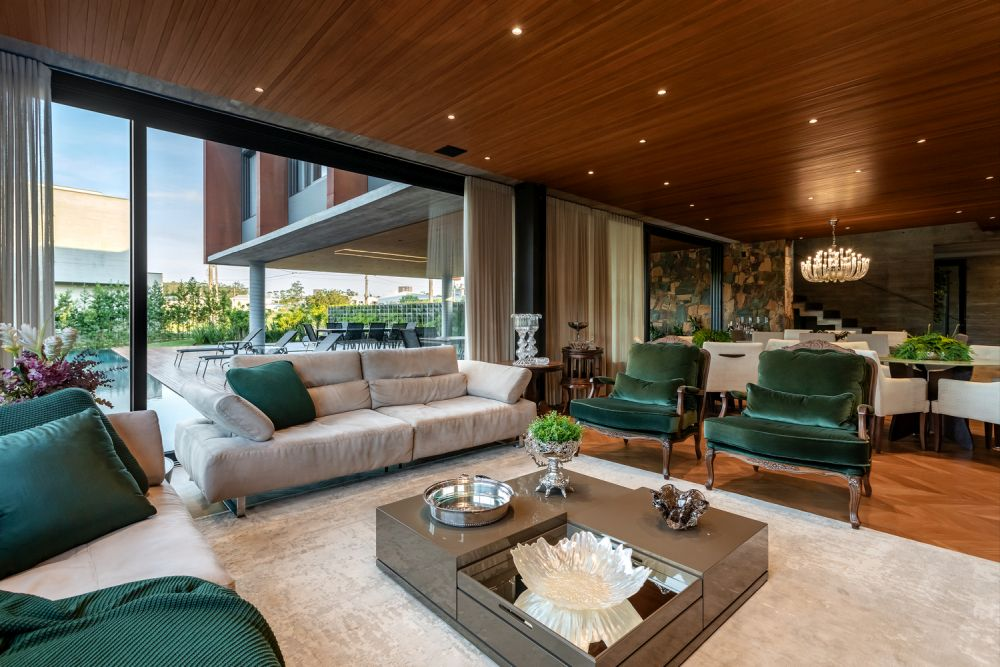 The living room has stylish wooden floors as well as a wooden ceiling with little lights embedded into it