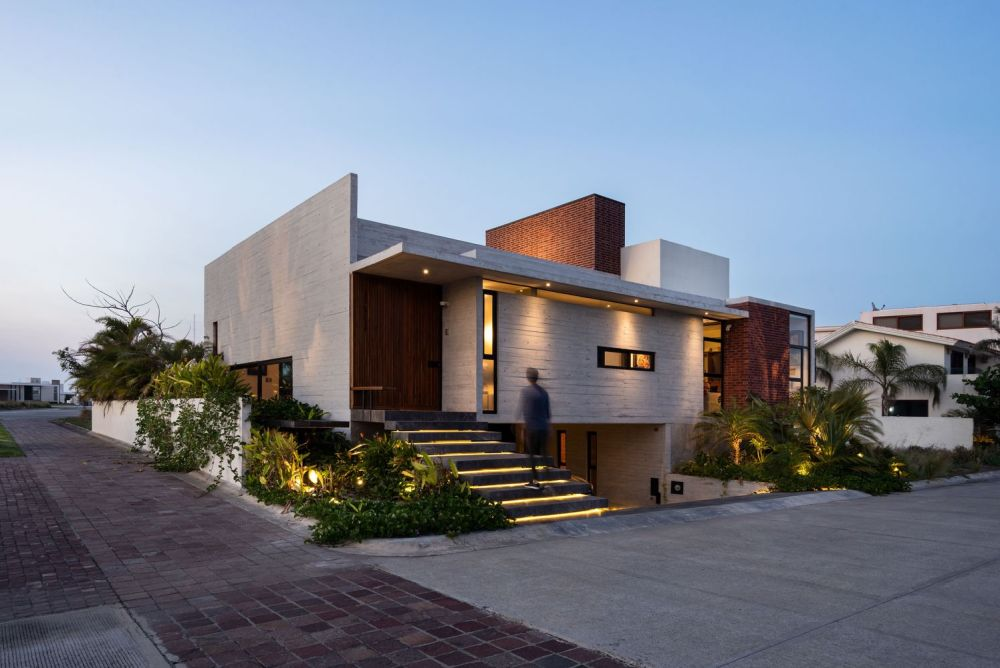The front of the house is mainly solid concrete with small windows for a bit of character