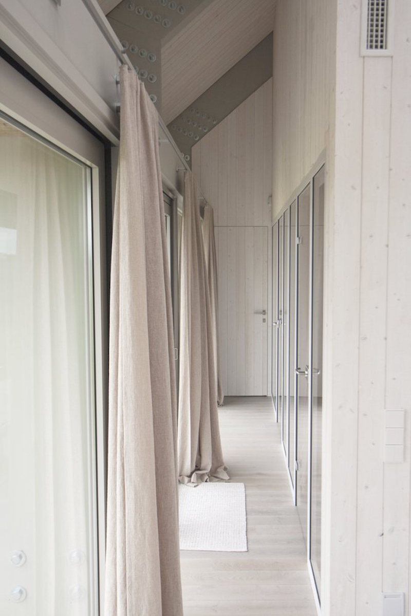 Dune House in Latvia hallway with curtains