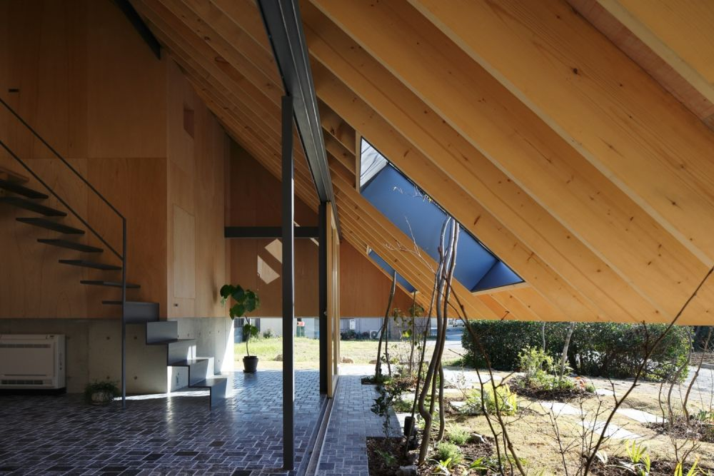 Cut-outs in the eaves act as windows that frame views of the surrounding outdoor area