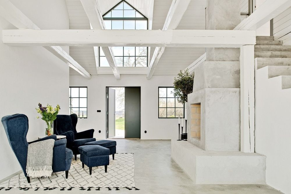 The fireplace is quite massive but seems small in the context of the great room and thanks to the high ceiling
