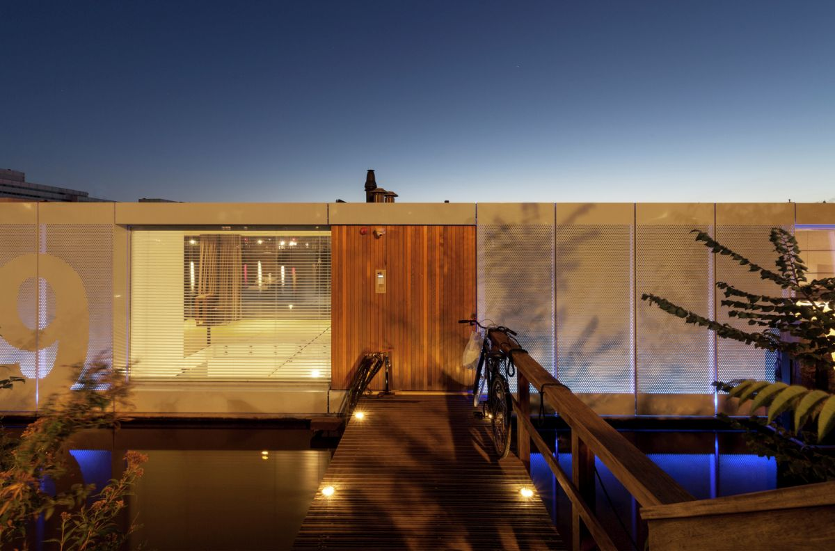 Floating Amsterdam home perforated facade at night