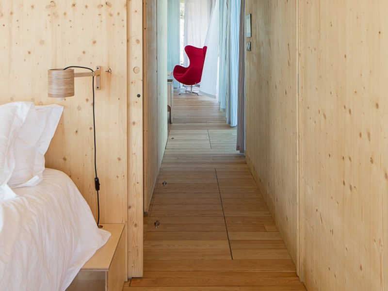 Floatwing hallway with wood paneled walls