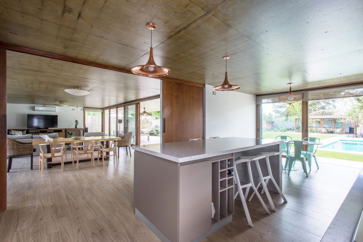 The architects used a variety of different concrete textures mixed with wooden surfaces to give the house a simple yet unique look