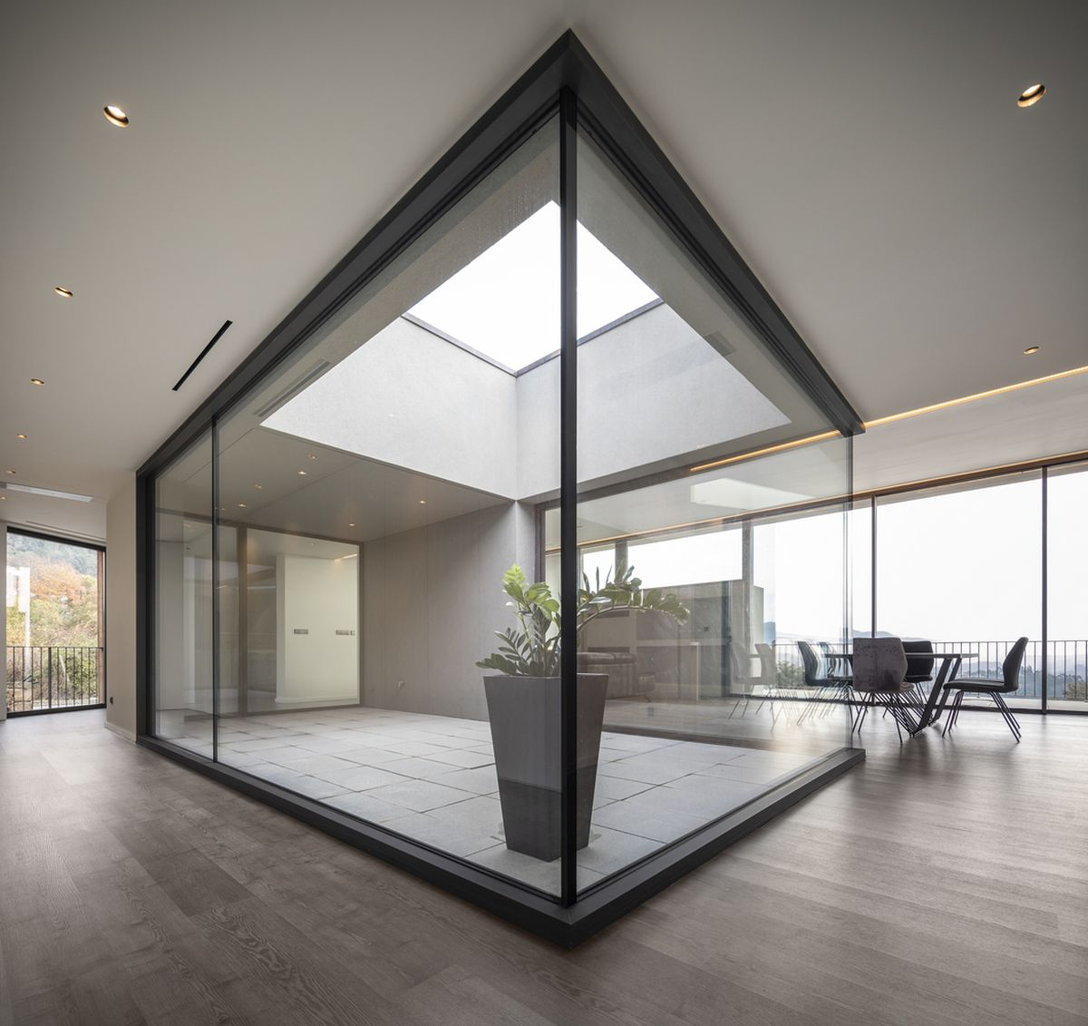 A series of skylights introduce natural sunlight into the main areas of the house