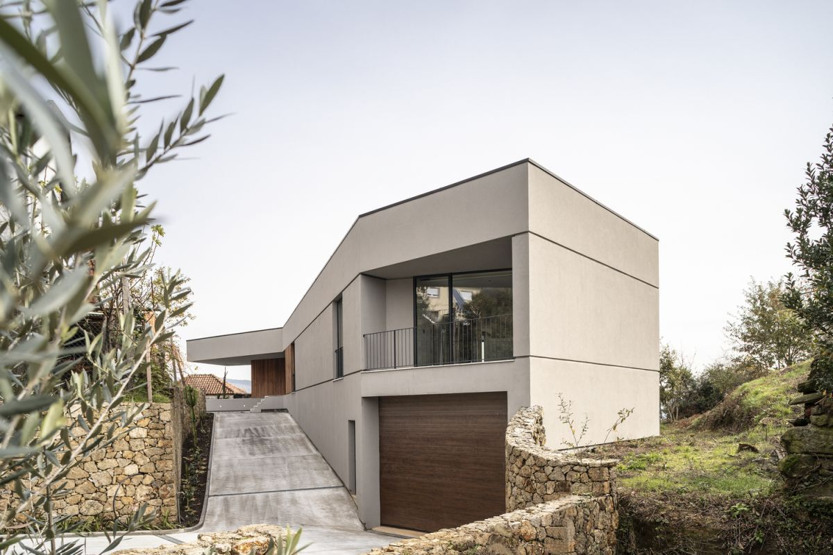 This is a house literally shaped by the landscape around it, with a design based on a lot of constraints
