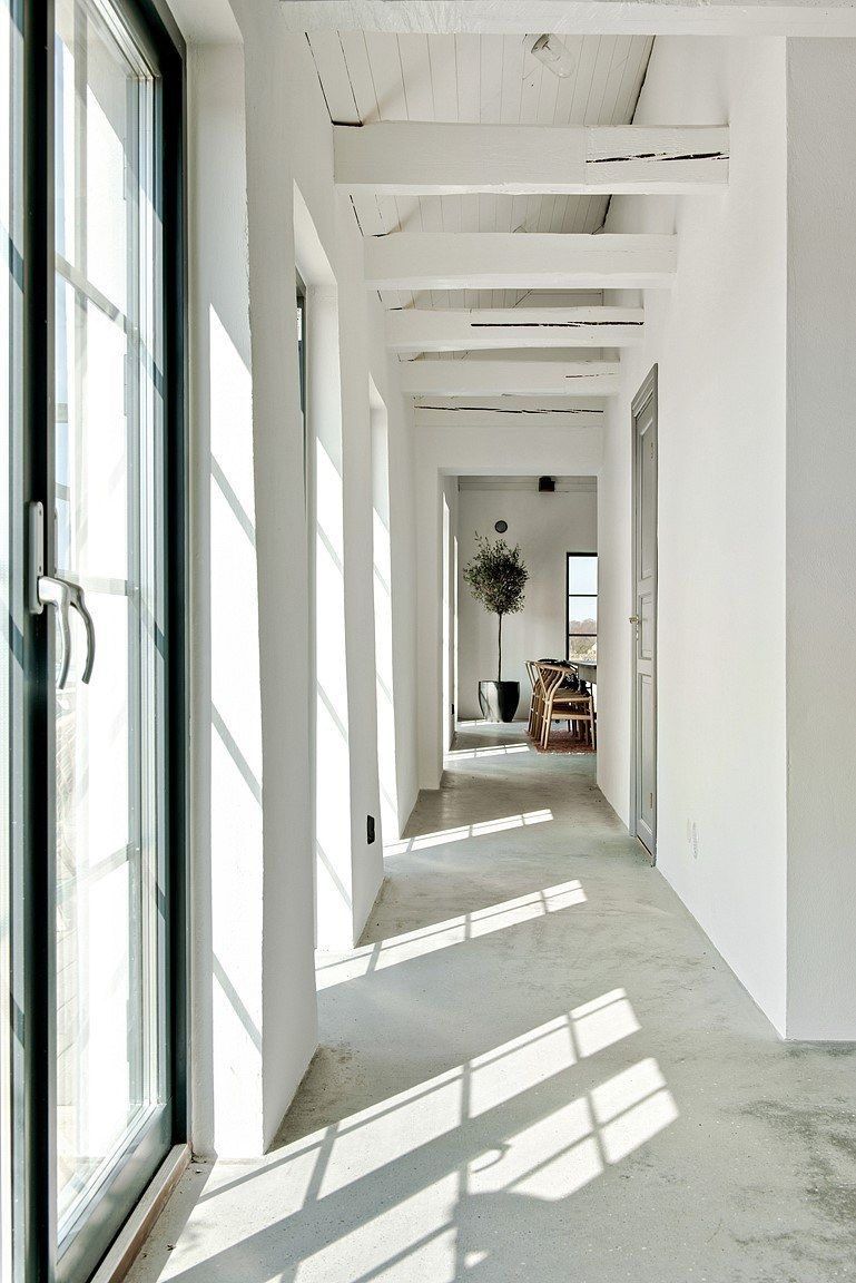 Floor-to-ceiling windows and skylights bring in an abundance of natural light and emphasize the house's open and airy feel