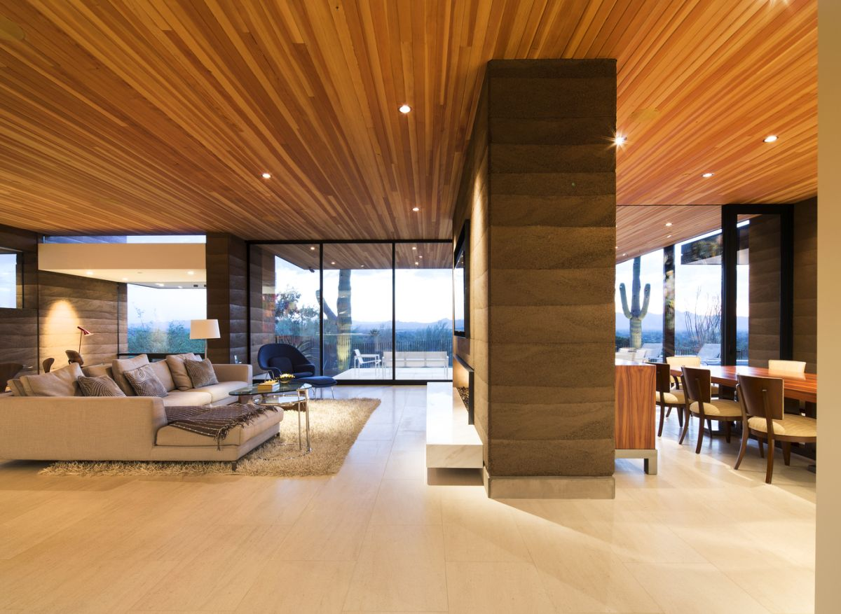 The living space and dining area share an open floor plan and are separated by a divider with a built-in fireplace