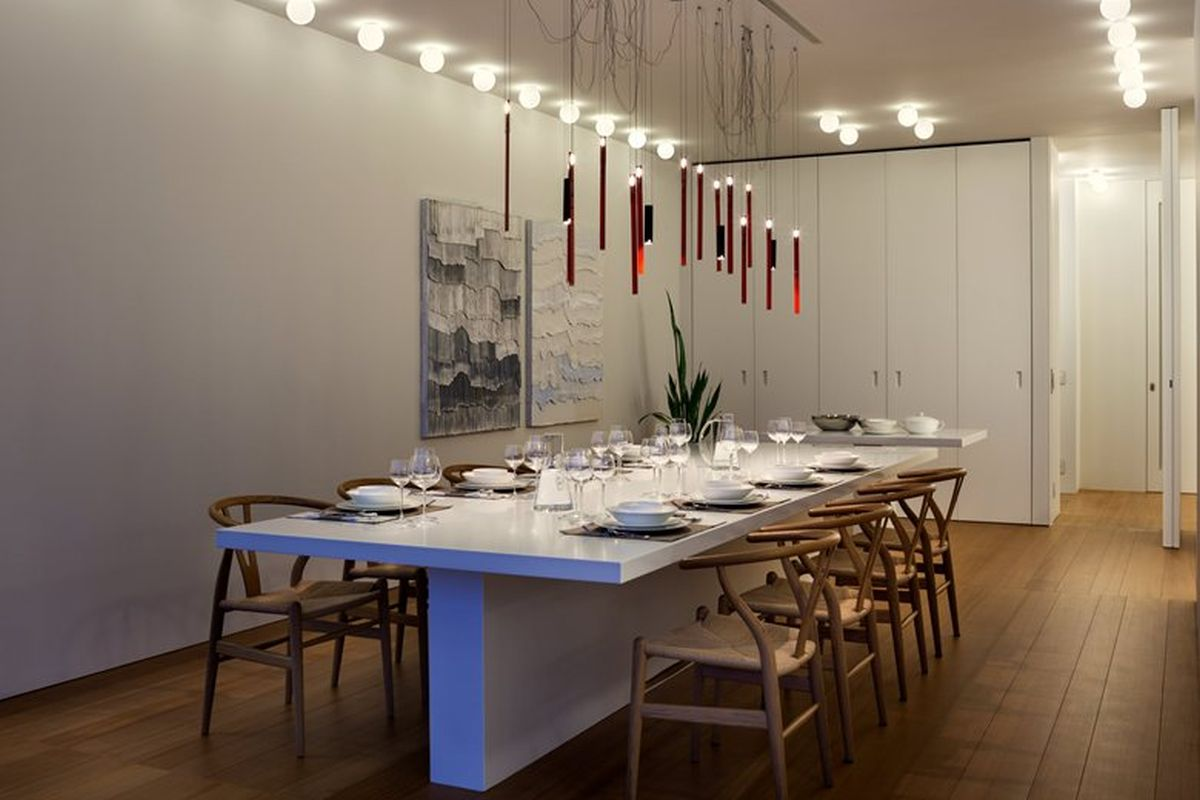 House C by Zaetta Studio dining table and chandelier