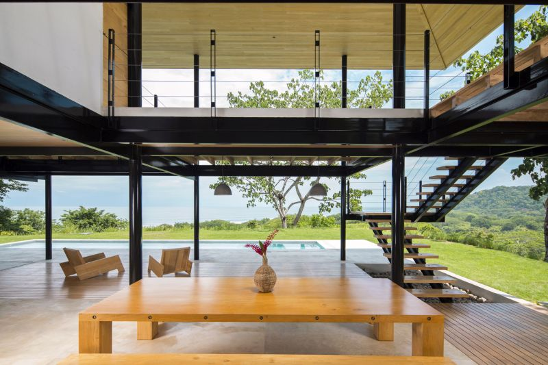 House between the ocean and the jungle dining area and deck