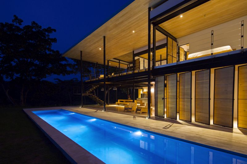 House between the ocean and the jungle pool al night