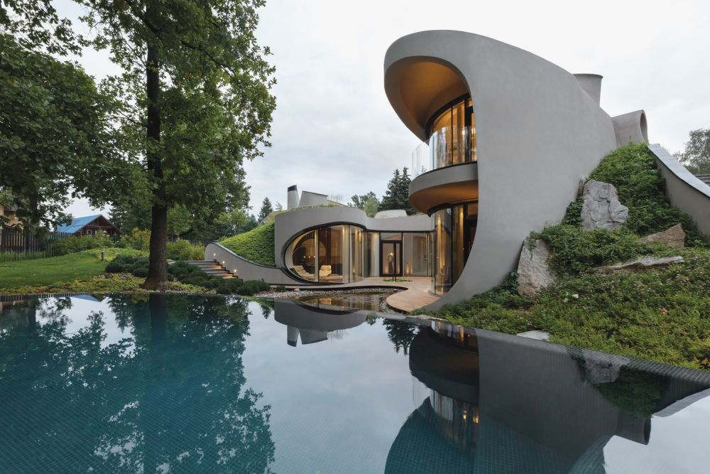 The building and the terrain that surrounds it seamlessly blend with one another