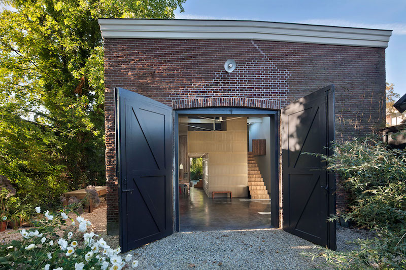 House of Rolf solid doors and brick exterior