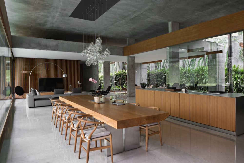 A big dining table for the whole family is part of main social area along with the kitchen
