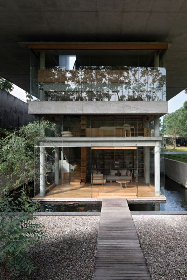 The main section of the house is surrounded by a reflective pool