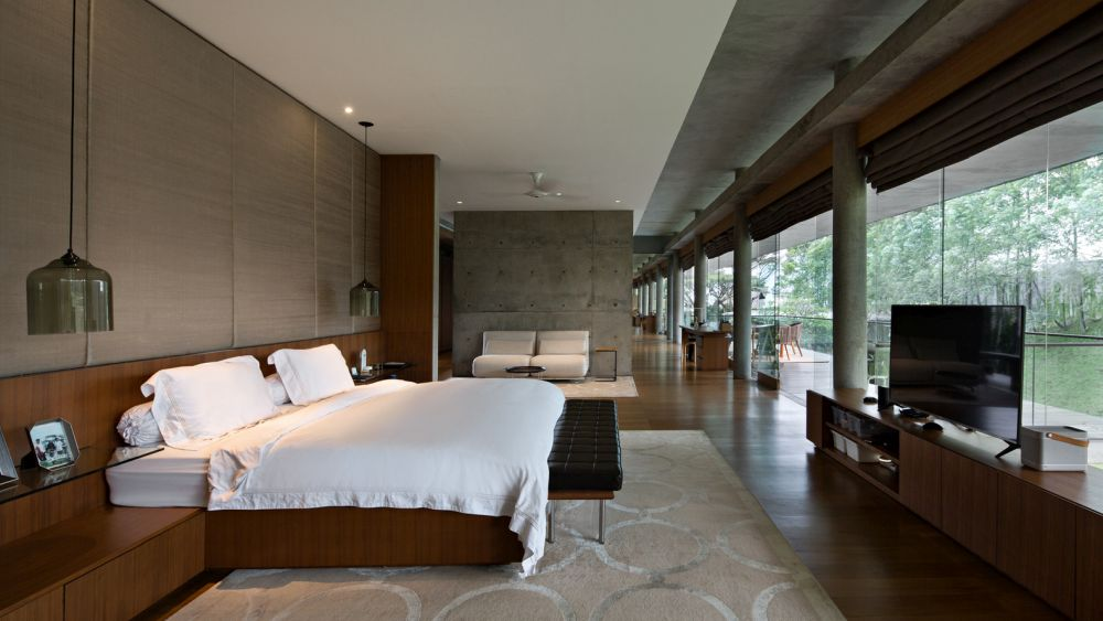 Exposed concrete walls and ceilings add a rugged twist to the interior design