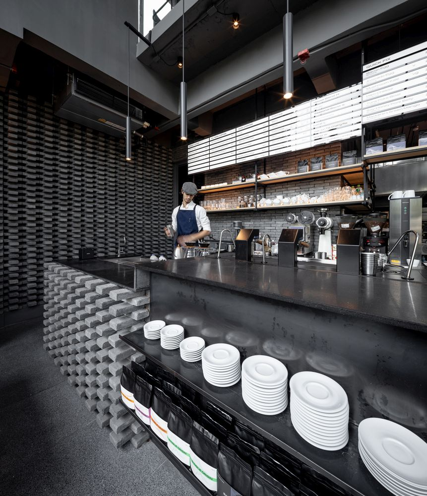 The neutral palette of colors shifts the focus towards the materials and finishes used throughout the shop