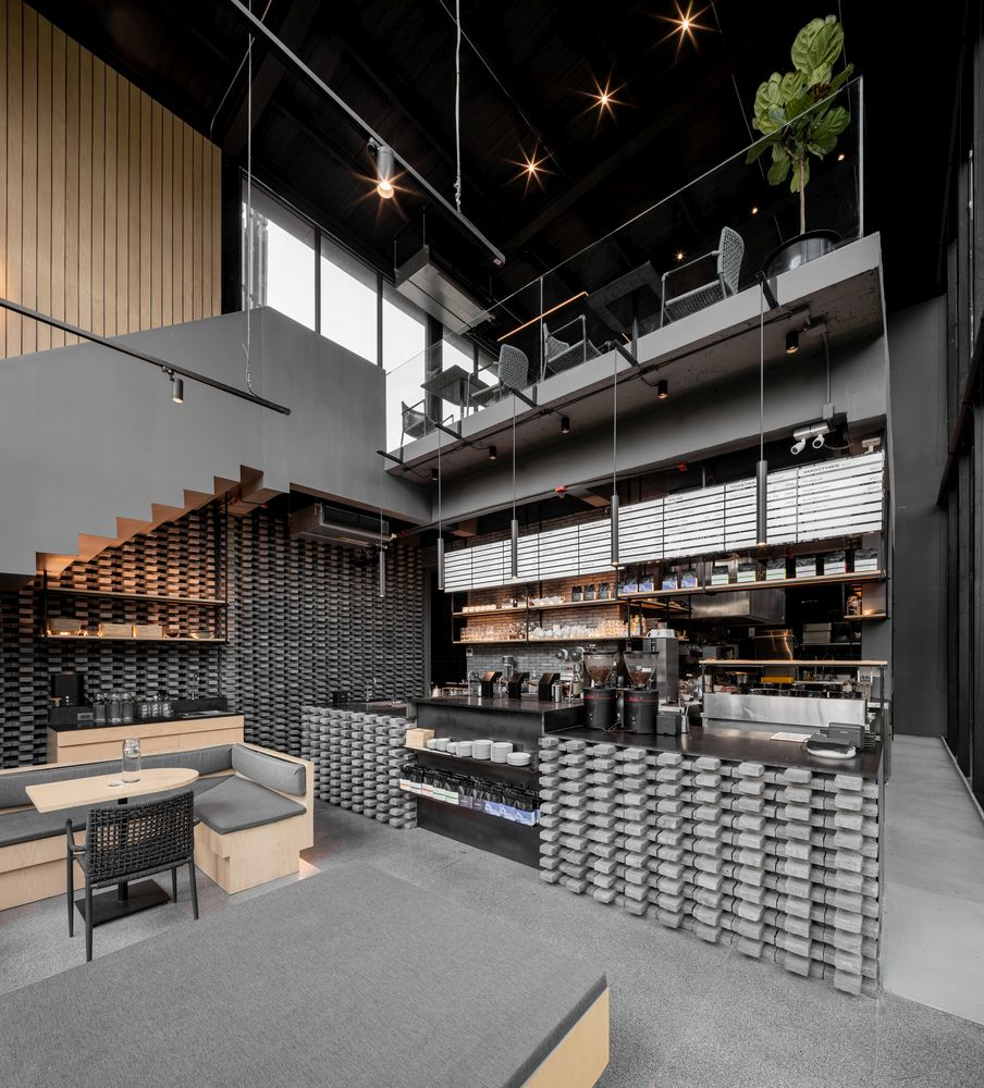 The upstairs seating area overlooks the bar below and has a clear view towards the street