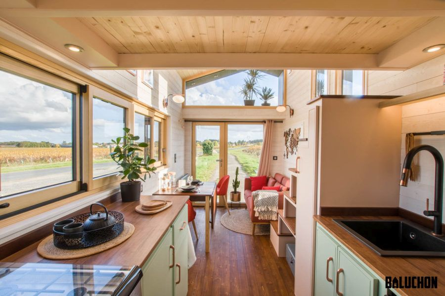 The multitude of windows helps to make this tiny house feel very airy and open