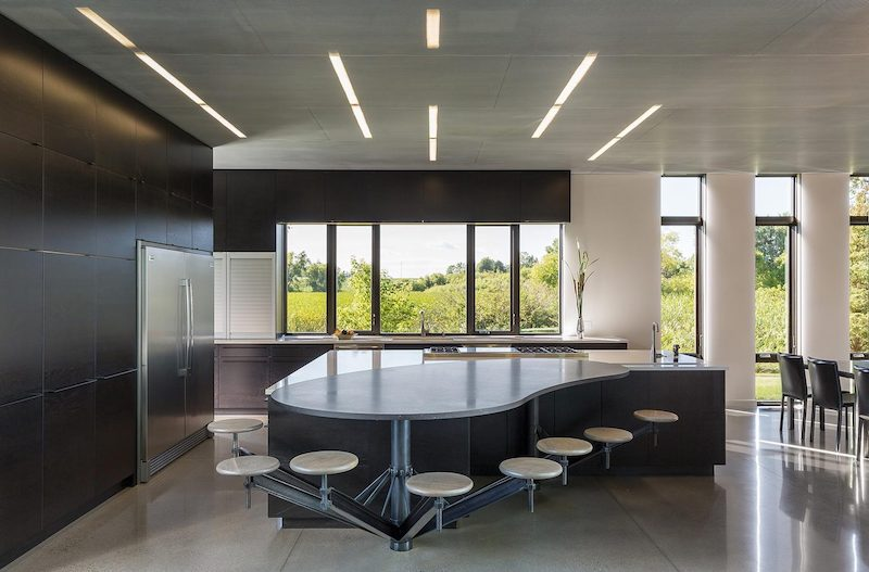 The kitchen is big and specious and features a very special island with seating for all family members